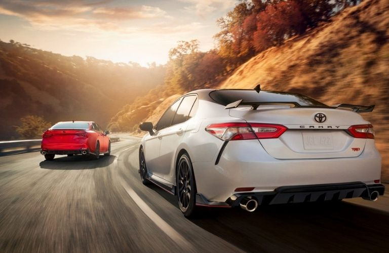 Two Toyota Cars, white and red, on the road