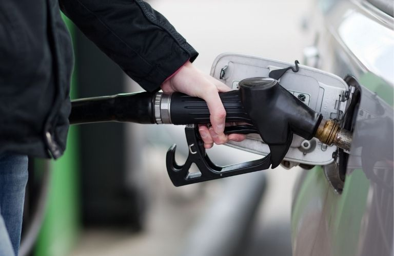 Image of a person gassing up a car