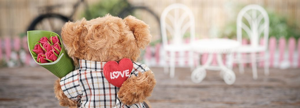 Teddy bear with roses going to a date
