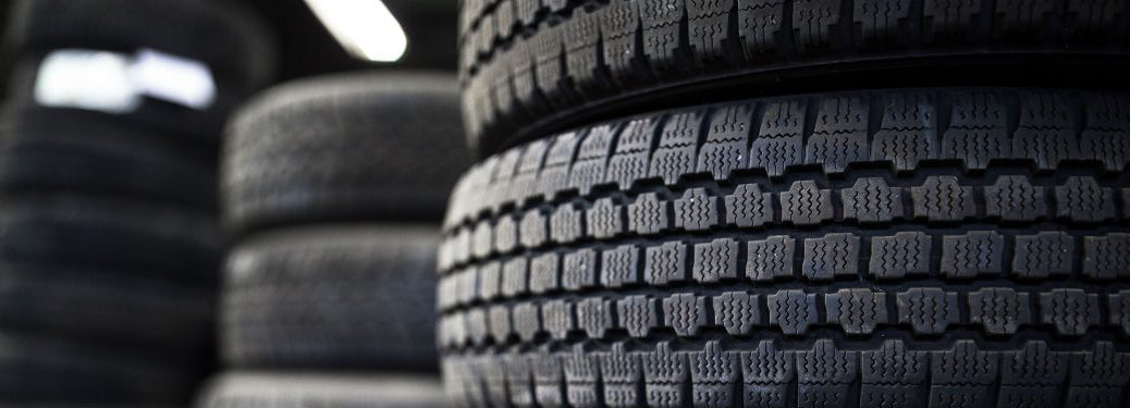 three stacks of tires at a tire store
