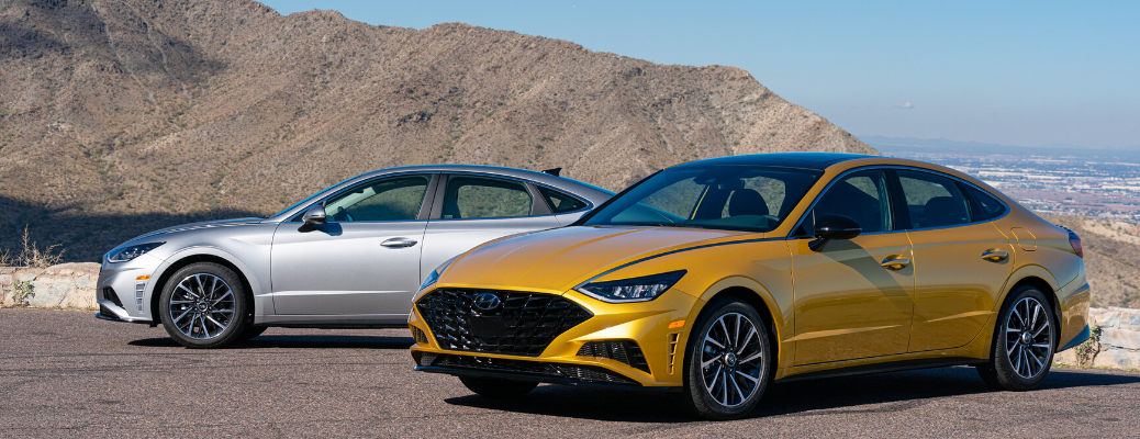 Two 2020 Hyundai Sonata vehicles in front of mountain