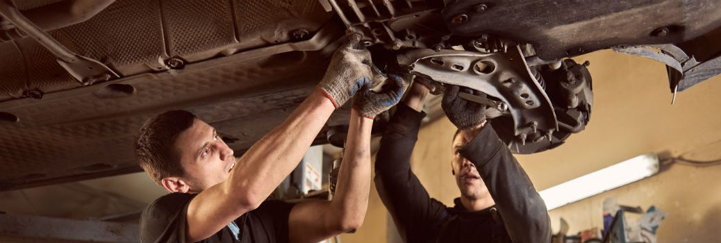 Two Mechanics Repairing Transmission