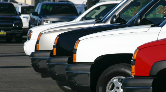 trucks lined up in dealership lot