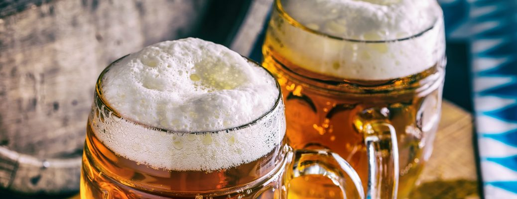 Two Craft Beers in Mason Jars with a Desirable Amount of Head