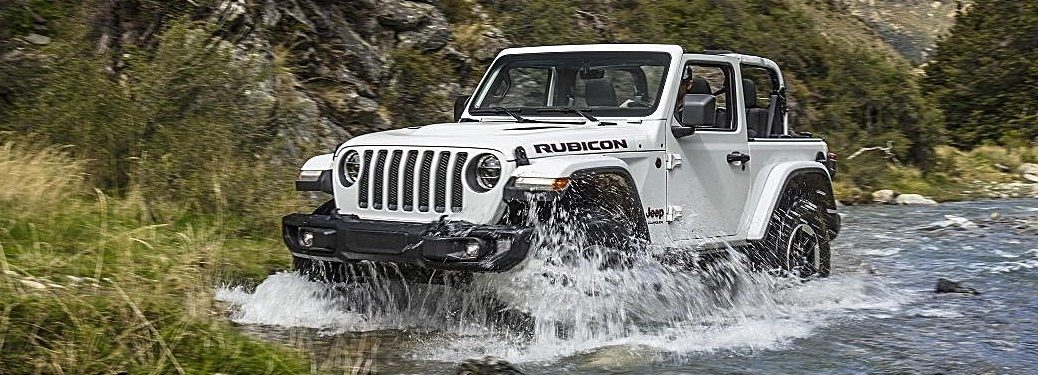2018 jeep wrangler white side view in a river