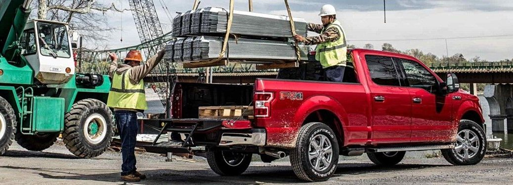 2018 Ford F-150 red back view with a load being placed in the bed