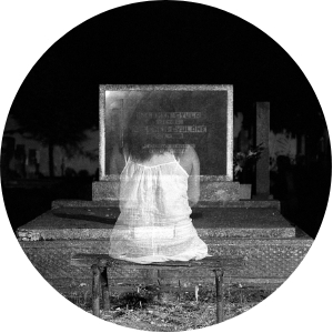 Girl ghost in front of a tombstone