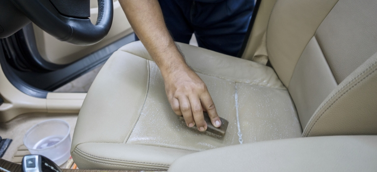 cleaning the leather seats of a car