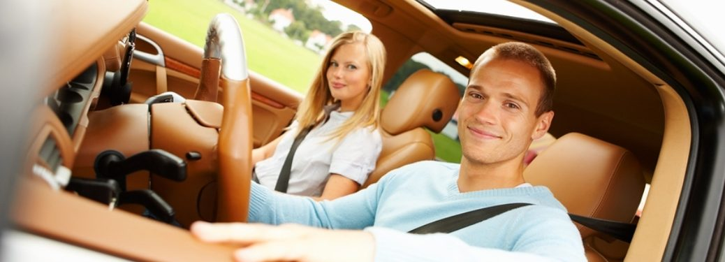 couple in a car with brown leather seats