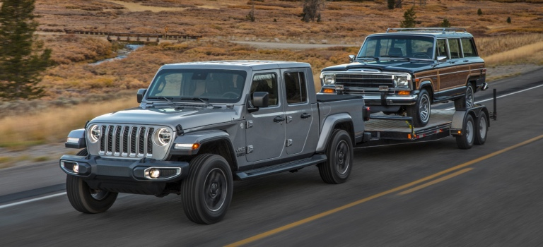 2020 Jeep Gladiator silver towing a boat front view