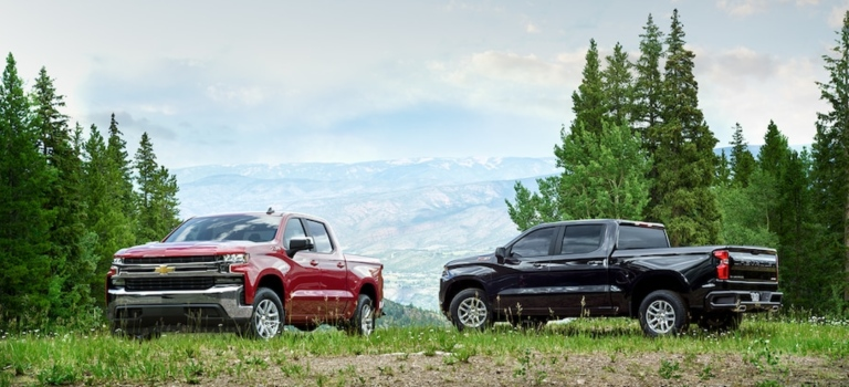 2019 Chevy Silverado in red and black on a mountain