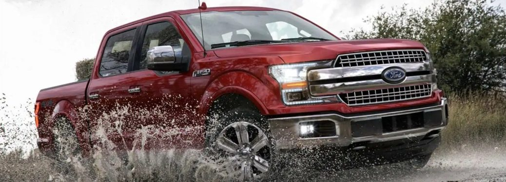 2019 Ford F-150 red side view in mud