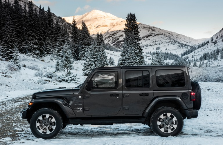 2019 Jeep Wrangler gray side view in snow