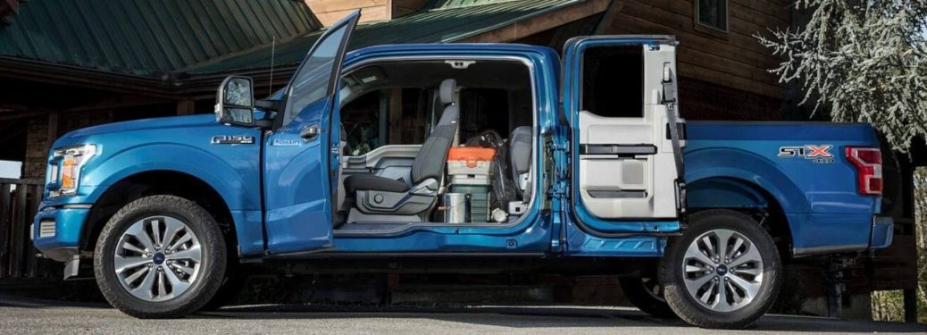 2019 Ford F-150 blue side view with cab door open