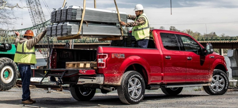 2019 Ford F-150 red side back view loading the bed