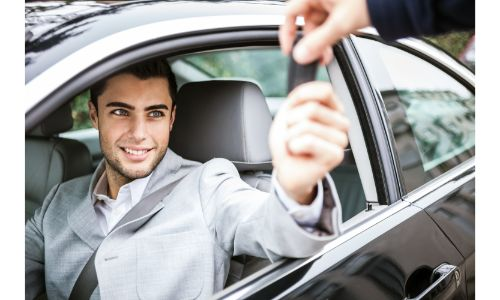 Man getting handed the keys to a car