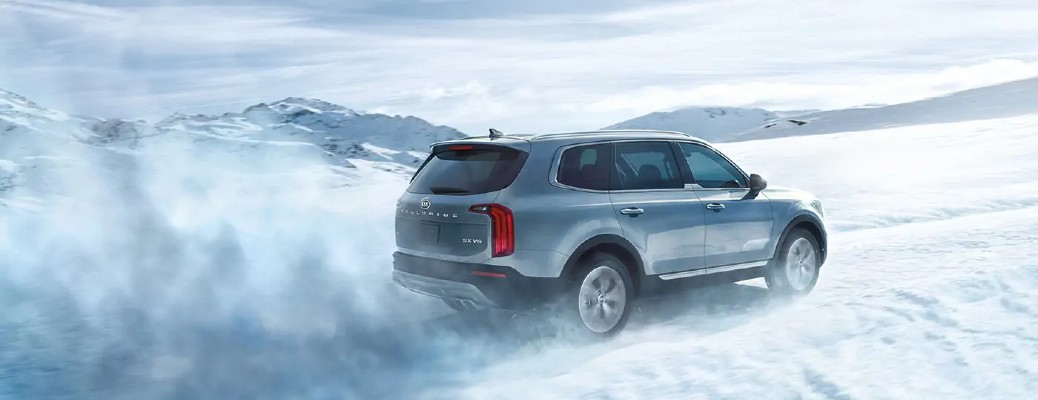 2021 Kia Telluride driving through snow blowing in the wind