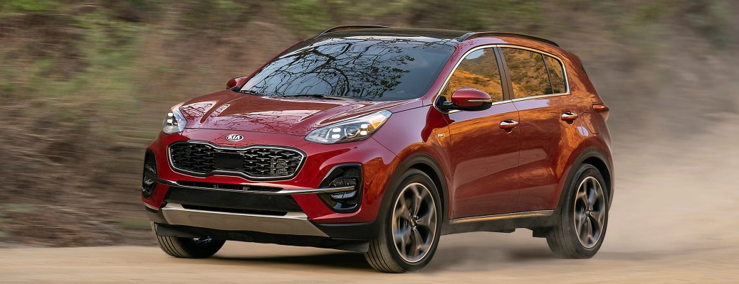 2021 Kia Sportage red driving on dirt throwing dust into the air