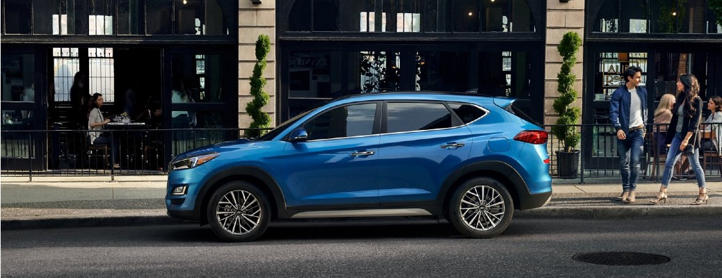 2020 Hyundai Tucson Ultimate Blue parked on site of street facing left