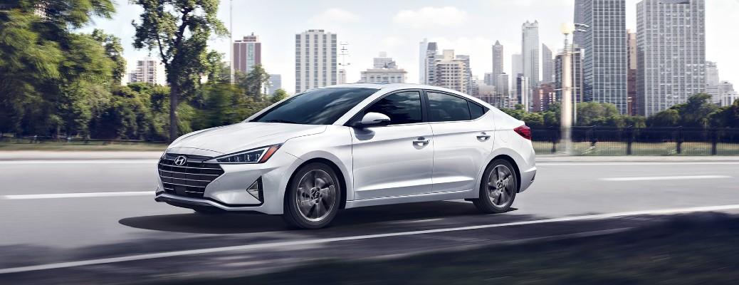 2020 Hyundai Elantra white driving outside city near park