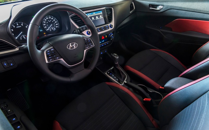 2020 Hyundai Accent interior showing front cabin with red accents