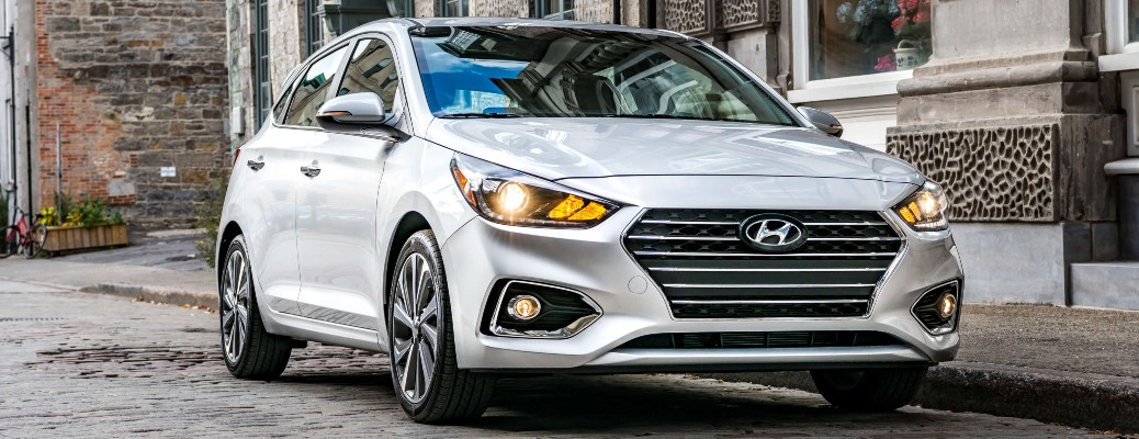 2020 Hyundai Accent white parked in cobblestone road 2018 shown