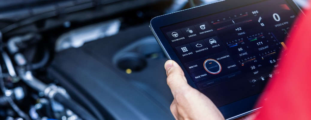 vehicle diagnostic tablet in use with open hood