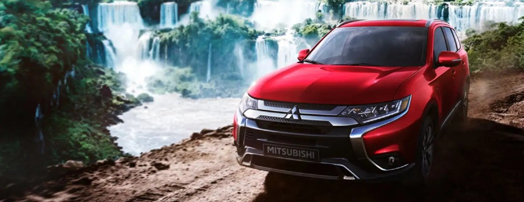 2020 mitsubishi outlander parked in front of waterfall