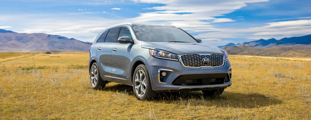 2020 Kia Sorento parked in dry grass with blue sky and mountains