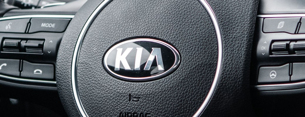 close up on Kia logo on steering wheel of 2021 Kia K5