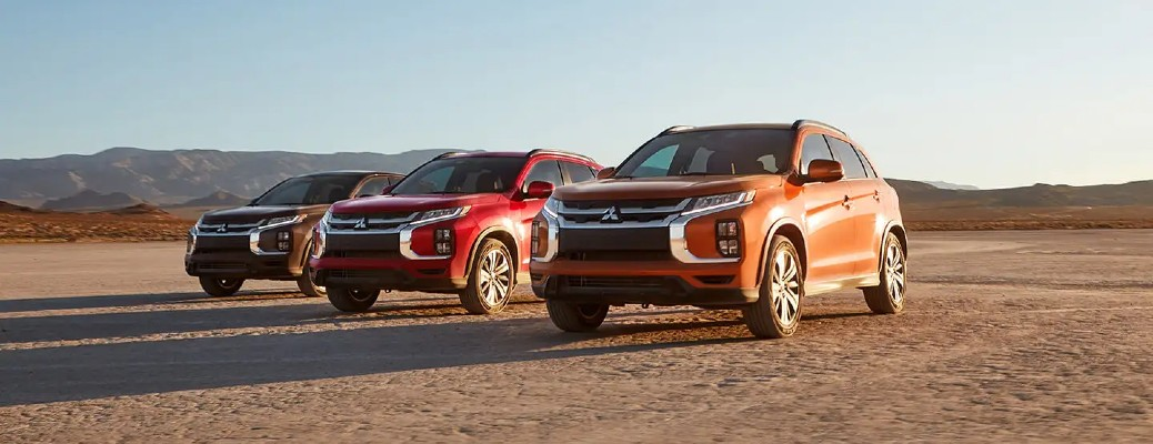 2020 Mitsubishi RVR red and brown lineup on flat dirt