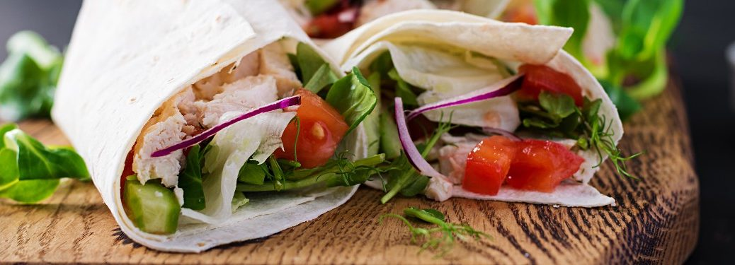 close up of sandwich wrap chicken and vegetables