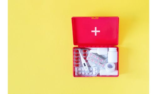 open first aid kit yellow background