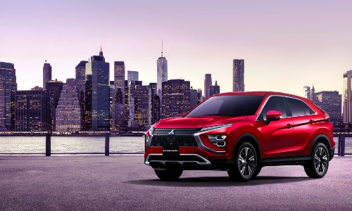 2022 Mitsubishi Eclipse Cross red parked by skyline waterfront
