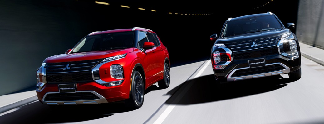 2022 Mitsubishi Outlander red and black models coming out of tunnel
