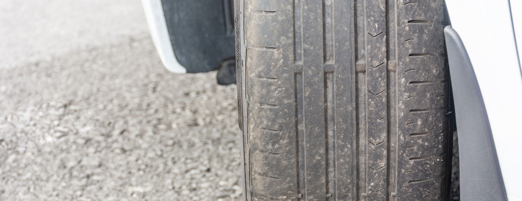 worn tire uneven wear front of car
