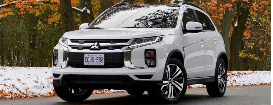 2021 Mitsubishi RVR White Front and Side View in Autumn