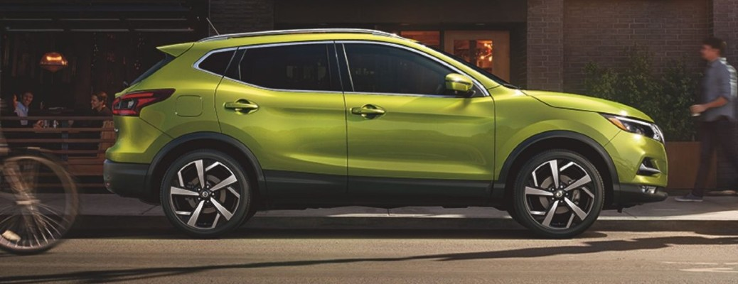 2020 Nissan Qashqai exterior side shot with Nitro Lime paint color parked on the side of a city street