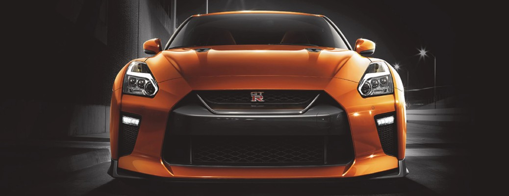 2021 Nissan GT-R exterior front shot of headlights and grille with Blaze Metallic paint colour