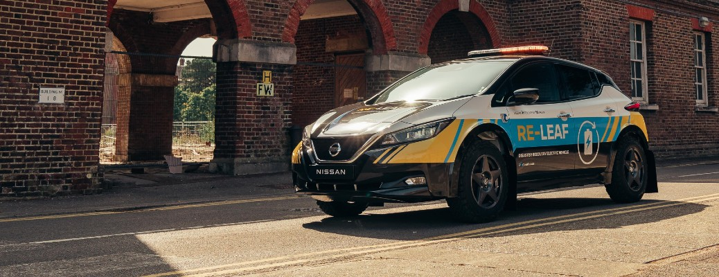 Nissan RE-LEAF electric emergency response vehicle concept parked next to brick building arches