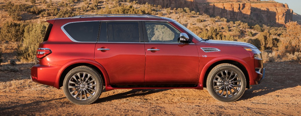 2021 Nissan Armada exterior side shot parked in a desert mountain wilderness