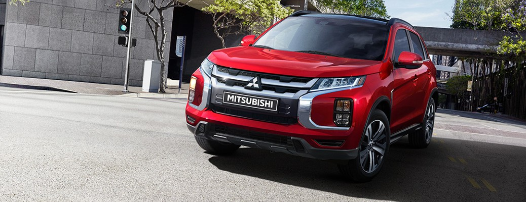 2021 Mitsubishi RVR exterior shot with Red Diamond paint colour driving through a city