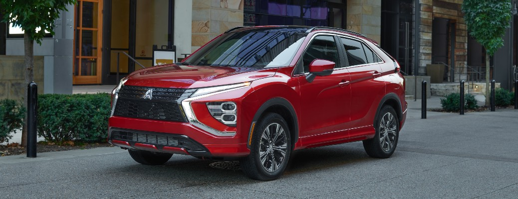 2022 Mitsubishi Eclipse Cross redesign exterior shot with red paint colour parked on a cobblestone plaza