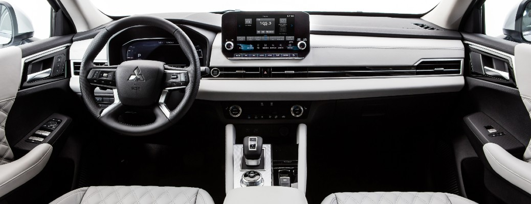 2022 Mitsubishi Outlander interior shot of front seating, steering wheel, transmission, and dashboard