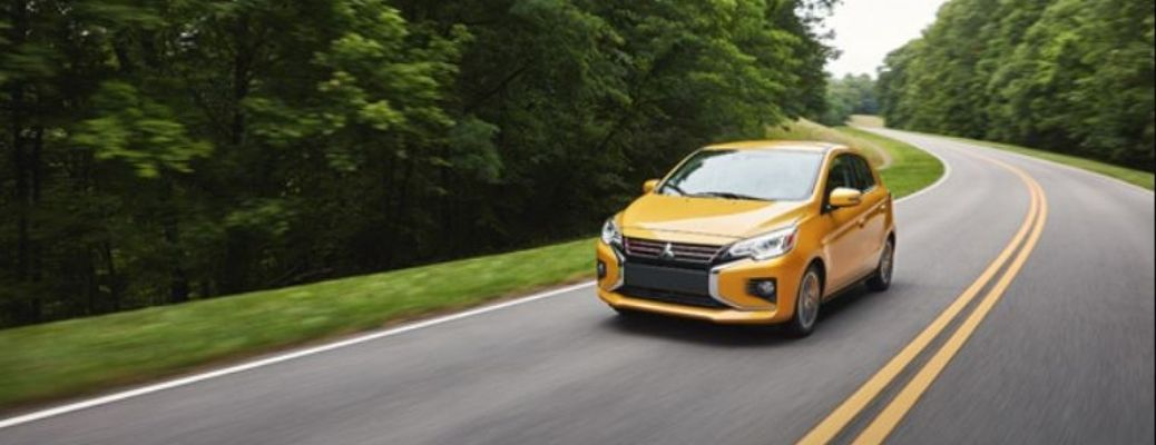 2022 Mitsubishi Mirage Yellow Front and Side View on the Road