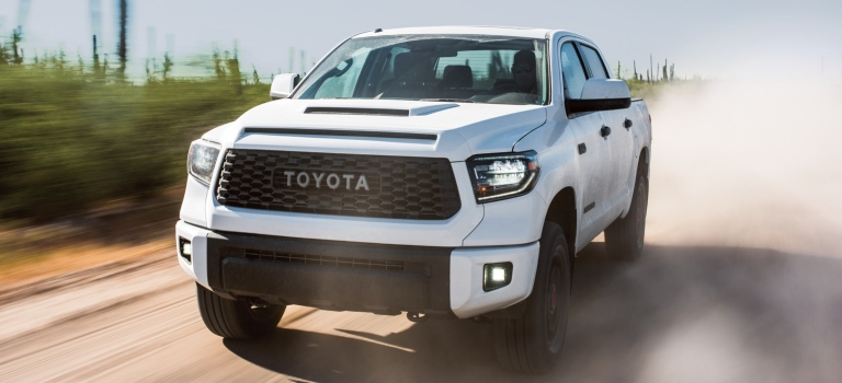 2019 Toyota Tacoma white front view in sand