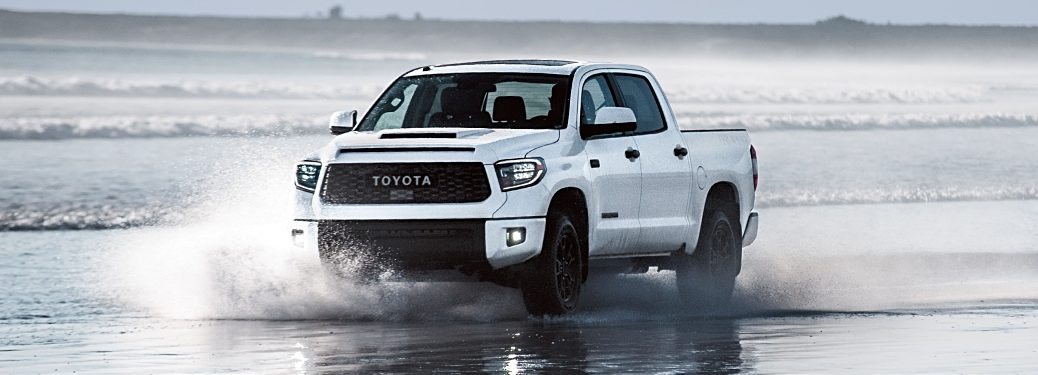 2019 Toyota Tacoma white front view in water