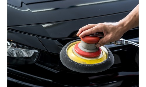 Buffering wheel polishing a car
