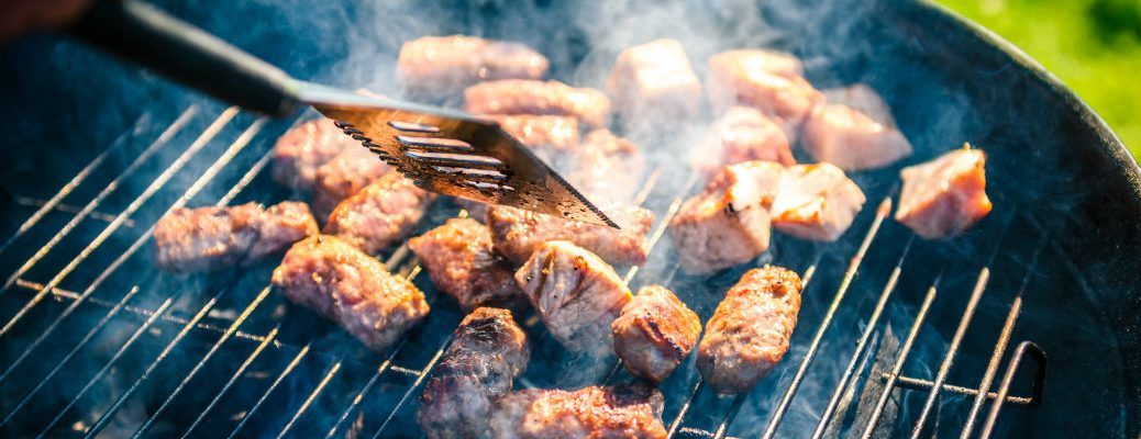 Grill full of cooking meats