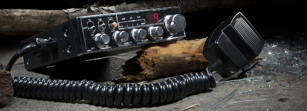 CB radio on top of wood and glass